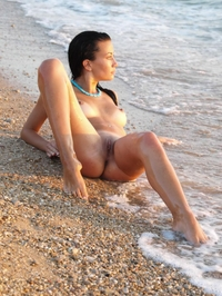 Sexy brunette mermaid Margo in the sea