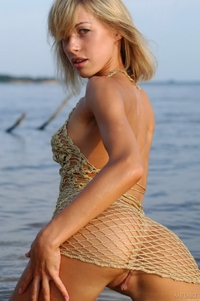 Sexy blonde Nikol naked in the lake