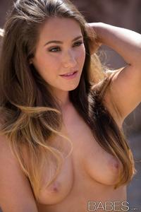 Sexy brunette Eva Lovia posing outdoor
