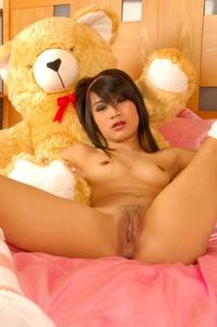 Cute Asian doll Sansanee spreading
