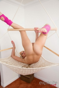 Cheeky blonde Eva Kay spreading