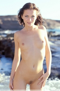 Sexy brunette Nina naked on the beach