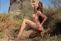 Gorgeous brunette Laura posing outdoor