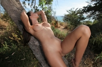 Gorgeous brunette Laura posing outdoor