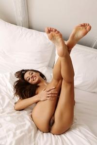 Cheeky brunette Dominika teasing