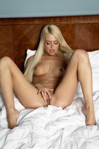 Cheeky blonde Lena G stripping