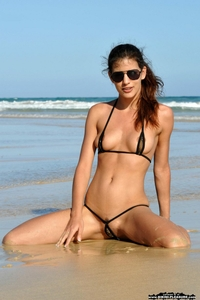 Skinny Candice Luca posing by the sea