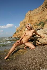 Hot blonde Tess drops her blue bikini