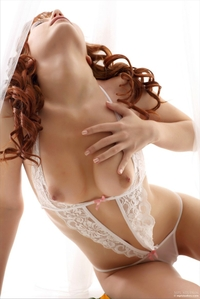 Young redhead Solana posing