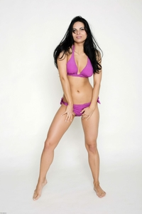 Sexy brunette Valentina's purple bikini