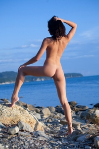 Tight ass Nivetta bending by the sea