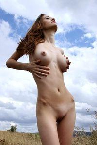 Beautiful brunette under the sky