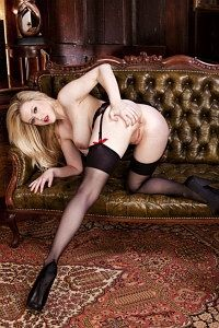 Blonde pussycat bending in sexy stocking