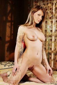 Gorgeous brunette Gisele posing