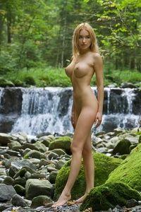 Blonde posing naked at the waterfall